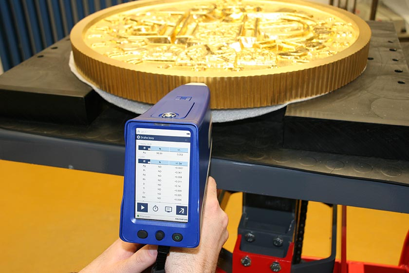 XRF gun testing the purity of gold (Au), ensuring 24 karat gold is being used for second largest gold coin in the world