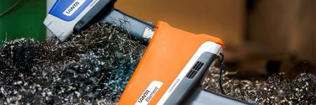 What Does an XRF Analyzer Cost? Vanta XRF gun for measuring scrap metal in recycling plant.