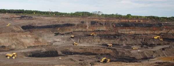 Panoramic view of the giant Sebuku Open Cut Thermal Coal Mine in Southern Kalimantan, Indonesia